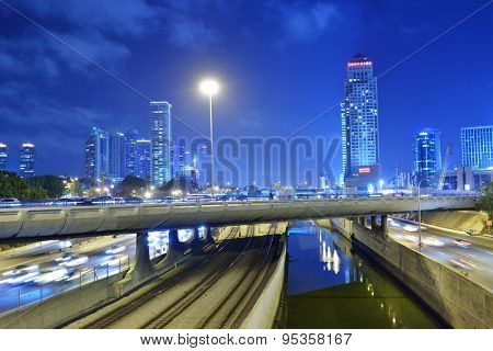 TEL AVIV, ISRAEL - MARCH 20, 2014: Night view of car traffic on the bridge across Ayalon river. Tel Aviv is an ultra-modern metropolis that was founded slightly over 100 years ago
