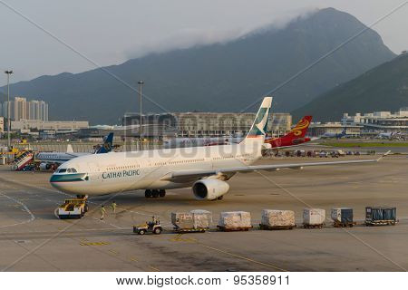HONG KONG - APRIL 17: jet aircraft in airport on April 17, 2014 in Hong Kong. Hong Kong International Airport  is one of the best airport in the annual passenger survey by Skytrax.