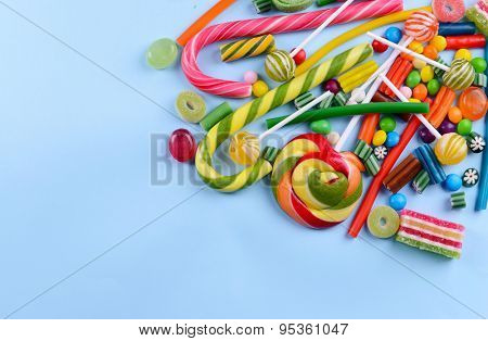 Colorful candies on light blue background