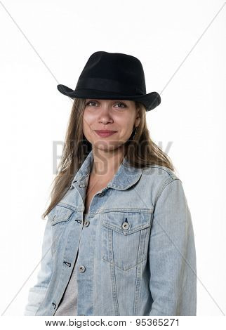 Young woman in a denim jacket and a black hat