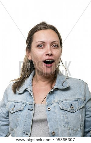 Portrait of a surprised young woman in a denim jacket