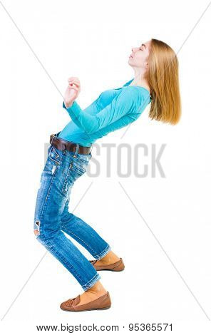 Balancing young woman.  or dodge falling woman. Rear view people collection.  backside view of person.  Isolated over white background. Girl in a blue shirt falls on his back.