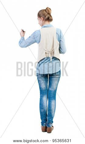 back view of writing beautiful woman. Young girl in jeans draws. Rear view people collection.  backside view of person. Isolated over white background. Girl in sleeveless felt-tip pen draws ahead.
