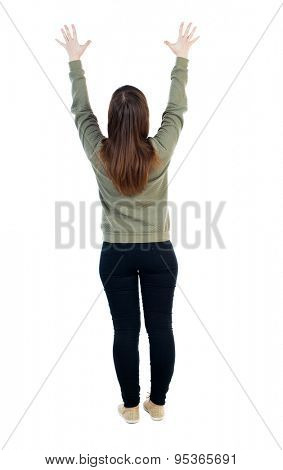 Back view of Beautiful woman looking at wall and Holds  hand up. young girl standing. Rear view people. Isolated over white background. Woman pulls a hand with fingers spread upward in prayer