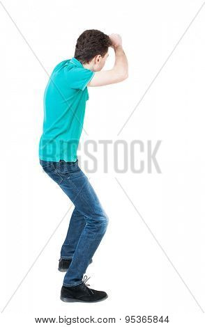 back view skinny guy funny fights waving his arms and legs. Isolated over white background. Rear view people collection.  backside view person. guy in the green shirt covered in fight with his fists
