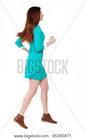 back view of running  woman. beautiful girl in motion. backside view of person.  Rear view people collection. Isolated over white background. girl in a stylish vintage dress runs right smiling.