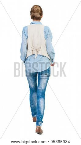 back view walking woman. beautiful girl in motion. backside view of person.  Rear view people collection. Isolated over white background. Girl in sleeveless goes forward with his hands in his pockets