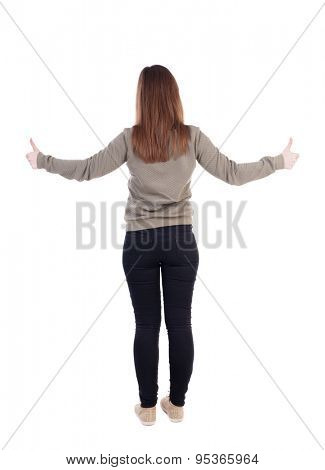 Back view of  woman thumbs up. Rear view people collection. backside view of person.   Two hands girl in a gray jacket shows the big finger.
