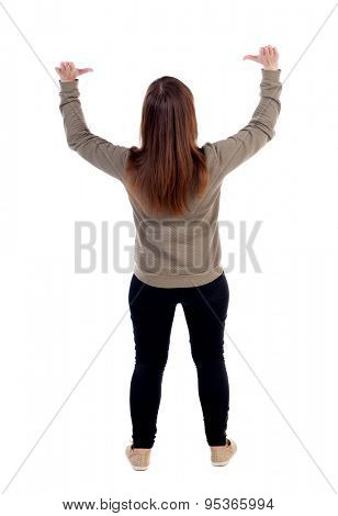 back view of woman  protects hands from what is falling from above. woMan holding a heavy load  backside view of person.  Isolated over white background.  Woman hands holding a cross over the grave.