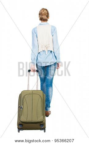 back view walking woman with suitcase. beautiful girl in motion. backside view person. Rear view people collection. Isolated over white background. Girl in blue shirt and sleeveless dragging suitcase
