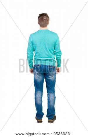 Back view of man in jeans. Standing young guy. Rear view people collection.  backside view of person.  Isolated over white background. The guy in the blue sweater looks up.