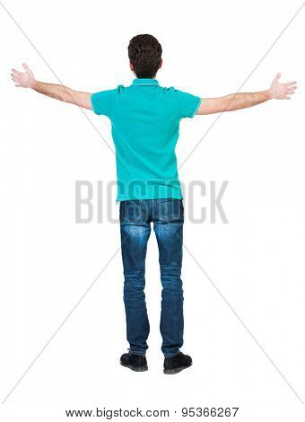 A man raised his hands in prayer.   Standing young man. Rear view people collection.  backside view of person.  Isolated over white background. A guy in a T-shirt is stylish aquamarine arms to side.
