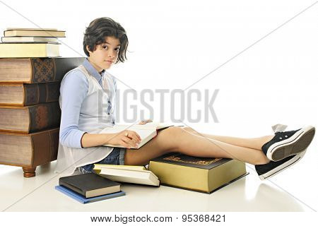 An attractive young teen looking up at the viewer from the book she's been reading.  She's surrounded by other  books, some giant sized.  On a white background.