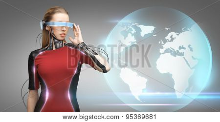 people, technology, future and progress - young woman with futuristic glasses and microchip implant or sensors over gray background over blue earth globe hologram