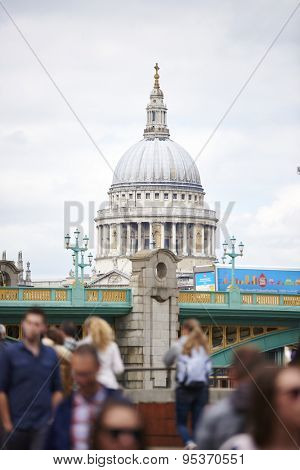 LONDON, UK - JUNE 23: Dome of Saint Paul's cathedral seen from Blackfriars, with blurred people in the foreground. June 23, 2015 in London.