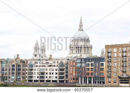 LONDON, UK - JUNE 23: Dome of Saint Paul's cathedral surrounded by lower buildings, seen from Blackfriars. June 23, 2015 in London.