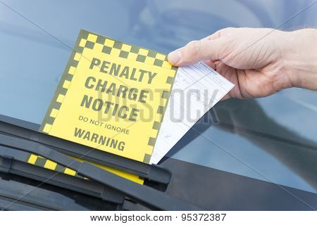 Parking ticket placed under windshield wiper