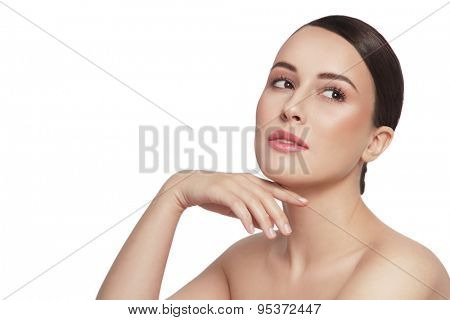 Young beautiful healthy happy woman touching her face and looking upwards over white background, copy space