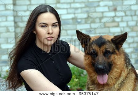 Teenager girl and German Shepherd dog