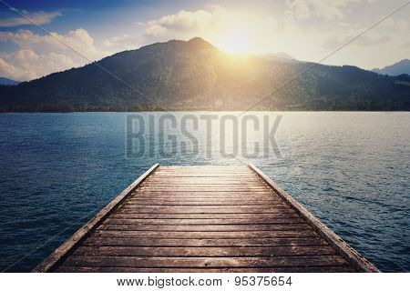 beautiful landscape with lake, moorage and hills
