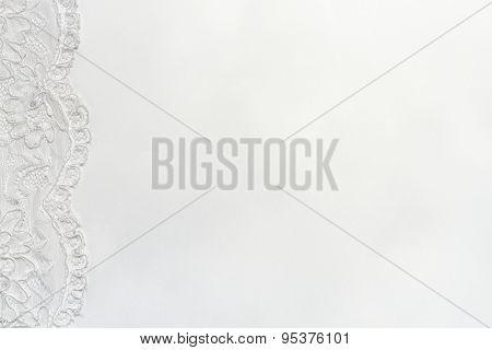 White Delicate satin background with lace border. Horizontal image.