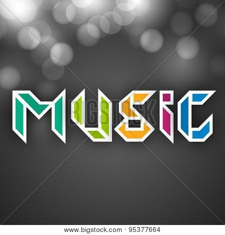 Stylish text of Music in different color on shiny grey background.