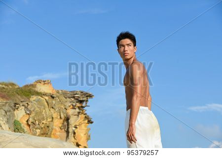 handsome man doing exercise in outdoors