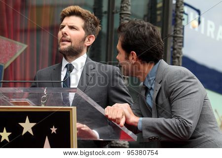 LOS ANGELES - JUL 1:  Adam Scott, Paul Rudd at the Paul Rudd Hollywood Walk of Fame Star Ceremony at the El Capitan Theater Sidewalk on July 1, 2015 in Los Angeles, CA