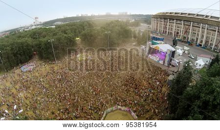 RUSSIA, MOSCOW - JUN 7, 2014: Football stadium Luzhniki with many people at festival of colours Holi. Aerial view. Photo with noise from action camera