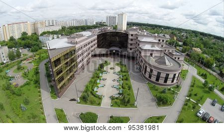 RUSSIA, MOSCOW - JUN 27, 2014: Aerial view edifice of diagnostic clinic in Solntsevo. Photo with noise from action camera