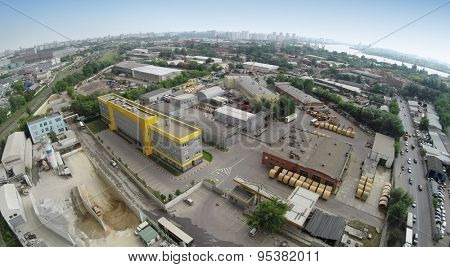 RUSSIA, MOSCOW - JUN 7, 2014: Aerial view of cement - concrete factory, Mechanization-2. Photo with noise from action camera