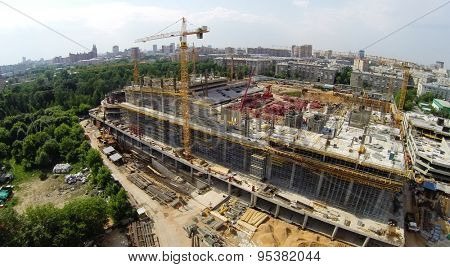 RUSSIA, MOSCOW - JUN 6, 2014: Townscape with construction site of football stadium CSKA at summer sunny day. Photo with noise from action camera