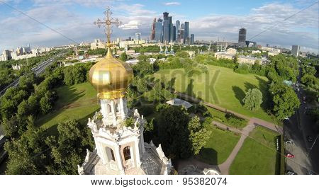 RUSSIA, MOSCOW - 19 JUN, 2014: Aerial view edifice of church Pokrova in Fili and cityscape with Moscow Business Center. Photo with noise from action camera