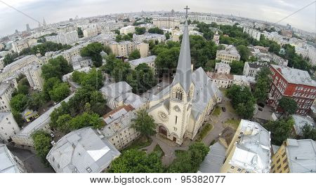 RUSSIA, MOSCOW - JUN 9, 2014: Aerial view of the Evangelical Lutheran Cathedral of Saints Peter and Paul. Photo with noise from action camera