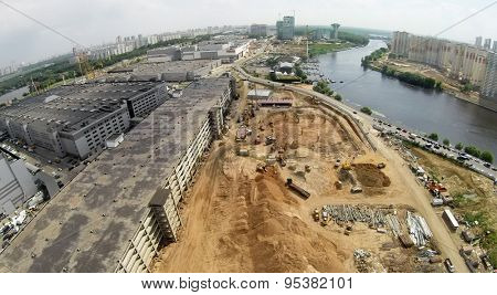 RUSSIA, MOSCOW - JUN 6, 2014: Building site of business center VEGAS Crocus City on shore of Moscow river at summer day. Aerial view. Photo with noise from action camera