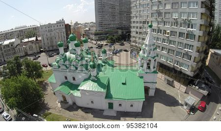 RUSSIA, MOSCOW - JUN 6, 2014: Aerial view  of Church of St. Simeon Stylites near New Arbat street with traffic at sunny summer day. Photo with noise from action camera