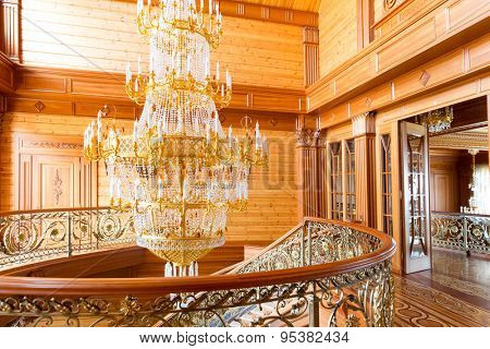 Novi Petrivtsi, Ukraine - May 27, 2015 Mezhigirya residence of ex-president of Ukraine Yanukovich. Close up of modern gilded chandelier