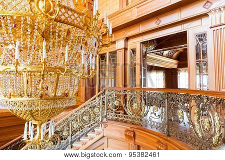 Novi Petrivtsi, Ukraine - May 27, 2015 Mezhigirya residence of ex-president of Ukraine Yanukovich. Closeup of modern gilded chandelier