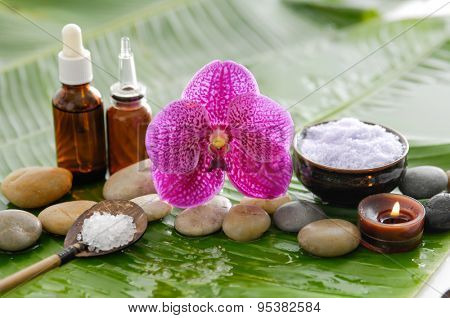 Spa set on banana leaf with red orchid