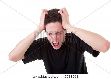 Strongly Afflicted Young Man, Screaming And Pulling Hair, On White Background. Studio Shot
