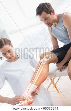Digital composite of Highlighted knee of injured man at physiotherapist