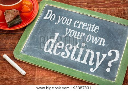 Do you create your own destiny question  on a slate blackboard with chalk and cup of tea
