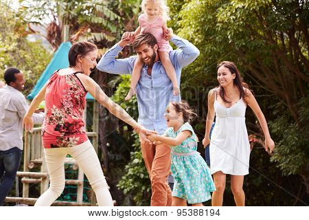 Adults and kids having fun playing in a garden