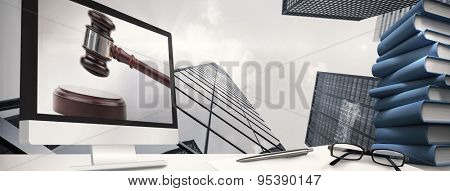 Computer screen against gavel banging