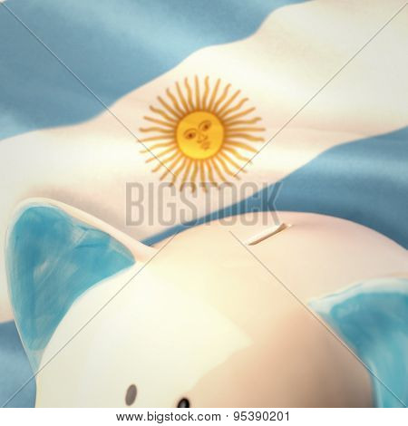 Piggy bank against argentinian flag