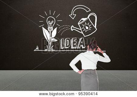 Businesswoman scratching her head against dark room