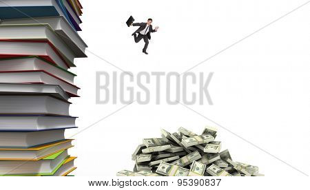 Smiling businessman in a hurry against stack of books