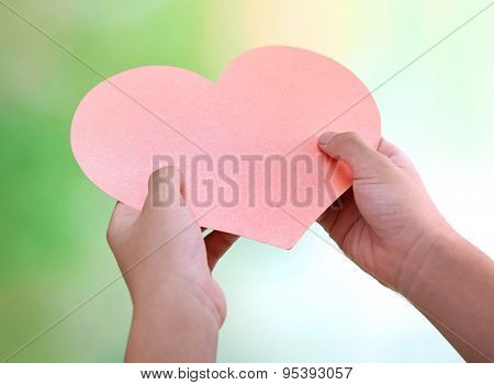 Heart in child hands