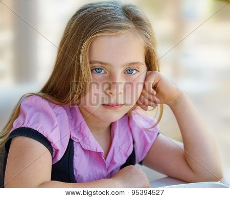 Blond relaxed sad kid girl expression blue eyes portrait