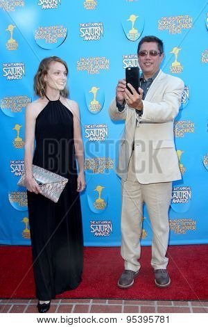 BURBANK - JUNE 25: Dean Devlin and wife arrives at the 41st Annual Saturn Awards on Thursday, June 25, 2015 at the Castaway Restaurant in Burbank, CA.